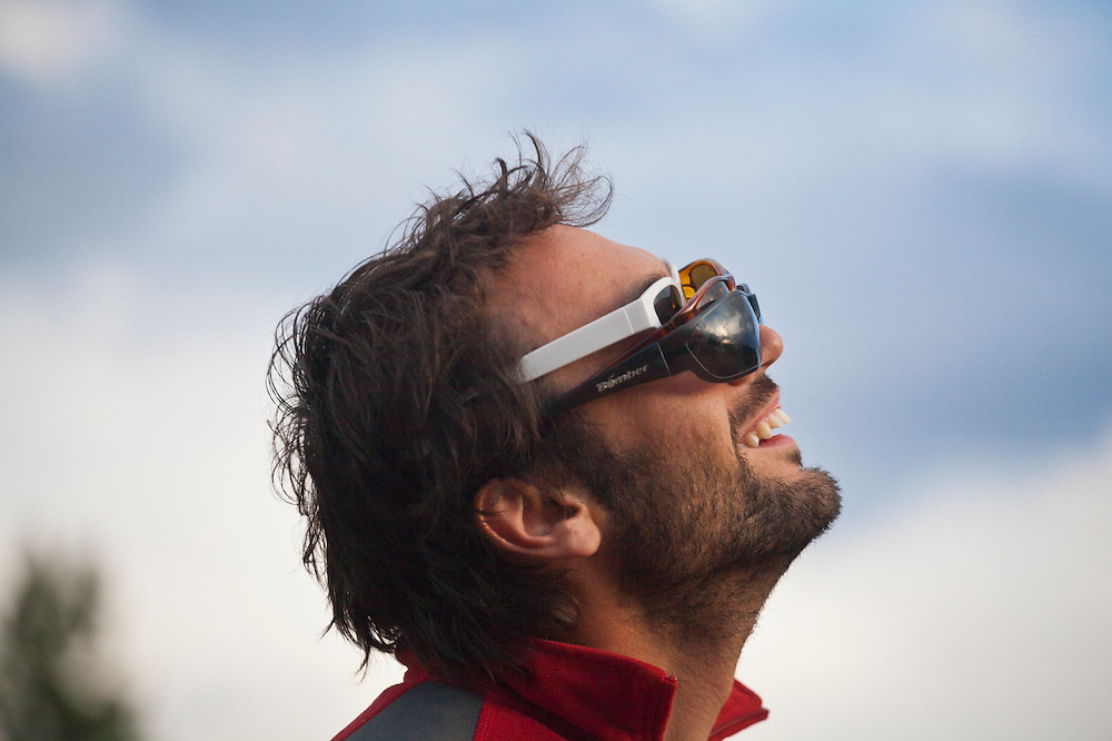 Marco Binotti watches the solar eclipse through three pairs of sunglasses on May 20, 2012 near Pine, Colorado.