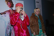 Andrew Logan and Gemma Winters. Zandra Rhodes- A Lifelong Affair with textiles.-Zandra Rhodes retrospective exhibition. Fashion and Textile museum. 1 February 2005. ONE TIME USE ONLY - DO NOT ARCHIVE  © Copyright Photograph by Dafydd Jones 66 Stockwell Park Rd. London SW9 0DA Tel 020 7733 0108 www.dafjones.com