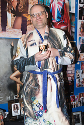 Shaun Smith, 52, from Basildon in Essex poses in a Cheryl Cole dressing gown he had made especially for himself. He has, at a cost of around £7,000 built up a huge collection of Cheryl Cole memorabilia in the space of about eight months after she impressed him in a music video he was watching.. PLACE, January 24 2019.