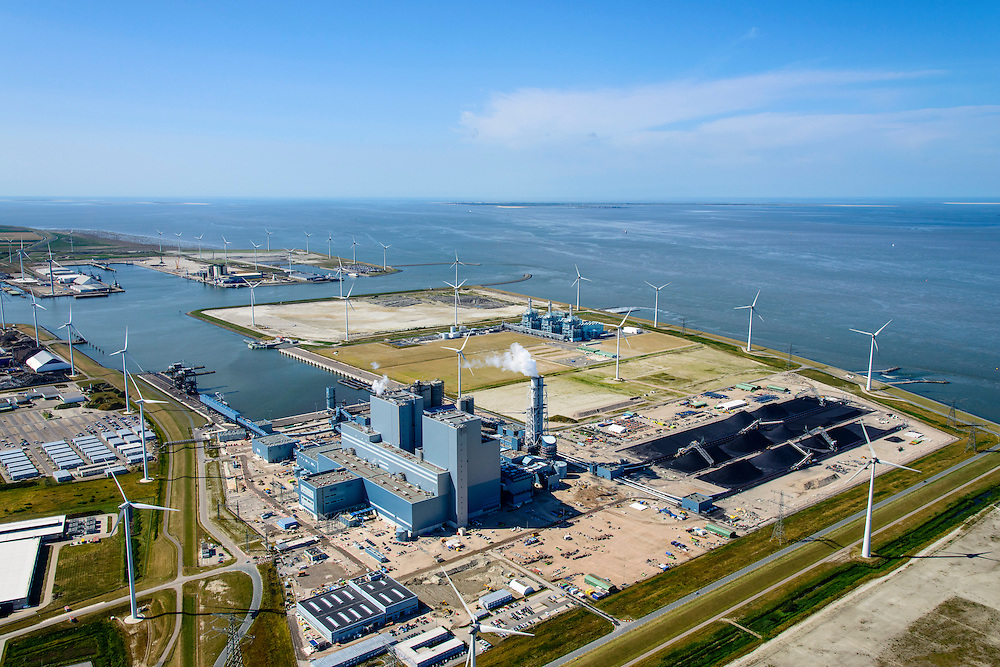 Nederland, Groningen, Eemshaven, 05-08-2014; Haven omzoomd door windmolens. Energie-landschap met elektricitieitscentrales: de RWE-Essent elektriciteitscentrale (voorgrond, kolencentrale) en de centrale van Nuon (achtergrond).<br /> <br /> Harbor area and energy landscape with wind turbines and different power plants: the coal fired  RWE-Essent plant (middle) and the Nuon (Magnum multi-fuel plant (background).<br /> <br /> luchtfoto (toeslag op standard tarieven);<br /> aerial photo (additional fee required);<br /> copyright foto/photo Siebe Swart