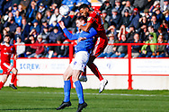 Portsmouth forward Oliver Hawkins (9) is beaten by Accrington Stanley defender Michael Ihiekwe (4), on loan from Rotherham United,   during the EFL Sky Bet League 1 match between Accrington Stanley and Portsmouth at the Fraser Eagle Stadium, Accrington, England on 27 October 2018.