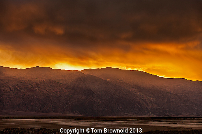 A winter storm moving effecting the sunrise over the Armagosa Range and the Grapevine Mountains. Image made from the Middle Basin of Death Valley and Salt Creek.