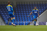 AFC Wimbledon defender Darnell Johnson (27) holding hand out and dribbling during the EFL Sky Bet League 1 match between AFC Wimbledon and Milton Keynes Dons at Plough Lane, London, United Kingdom on 30 January 2021.