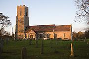 Rural parish church of Saint John the Baptist on a winter evening, in the village of Snape, Suffolk, England
