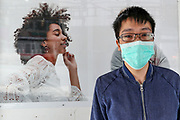 A young Asian boy wearing face protective mask poses in front of the camera near Tottenham Court Road underground station in central London on Monday, May 11, 2020. <br />
