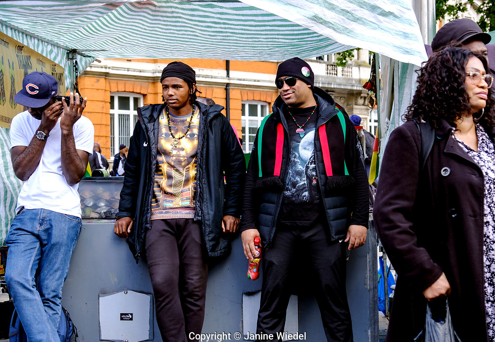 People at Reparations Revolution event on Afrikan Emancipation Day in Windrush Square, Brixton 2021.