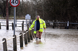 © Licensed to London News Pictures. 03/01/2014<br /> Yalding resident Bill Bird walking along Lees Road in Yalding which is now a river.<br /> The Medway River in Yalding has burst its banks again flooding Large parts of Yalding including Little Venice Country Park and The Lees.<br /> Flood waters are back again in Kent as Gales and heavy rain hit the UK over night.<br /> Photo credit :Grant Falvey/LNP
