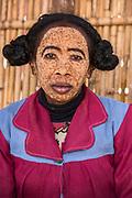 Local woman<br /> Near Morondava<br /> Southwest Madagascar<br /> MADAGASCAR<br /> Sandalwood paste