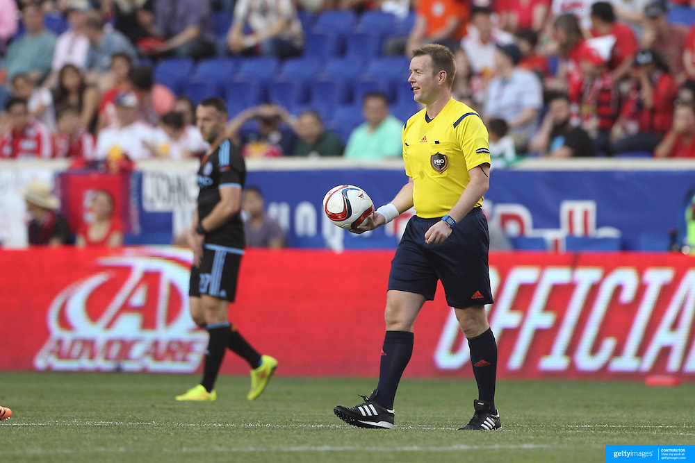 Referee Alan Kelly with a flat football during the New York Red Bulls Vs NYCFC, MLS regular season match at Red Bull Arena, Harrison, New Jersey. USA. 10th May 2015. Photo Tim Clayton