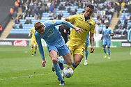 Coventry City defender Tom Davies  (5) battles for possession  with Bristol Rovers forward Johnson Clarke-Harris (19) during the EFL Sky Bet League 1 match between Coventry City and Bristol Rovers at the Ricoh Arena, Coventry, England on 7 April 2019.