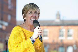 © Licensed to London News Pictures . 04/10/2015 . Manchester , UK .  JULIE HESMONDHALGH speaks in front of people at a demonstration against the Conservative government , organised by The People's Assembly , through Manchester City Centre , during the first day of the Conservative Party Conference in Manchester . Photo credit: Joel Goodman/LNP