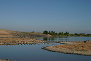 View of Snettisham RSPB Reserve, Norfolk, with various birds, salt marsh and mud flats