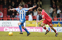 Photo: Leigh Quinnell.<br /> Swindon Town v Chester City. Coca Cola League 2. 24/02/2007. Chesters Alan Kearney gets away from swindons Michael Pook.