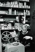 Andy Warhol, working with film at home