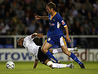 Photo: Rich Eaton.<br /> <br /> Shrewsbury Town v Fulham. Carling Cup. 28/08/2007. Fulham's Diomansy Kamara (l) is felled by Shrewsbury's Dave Hibbert (r).