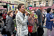 Tourists eating sandwiches, Nowy Square, Cracow, Poland