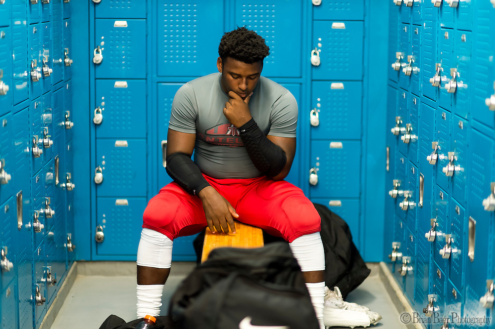 Antelope High School Titans Devin Dye (5), gets ready inside the locker room before the game as the Oakmont High School Vikings host the Antelope High School Titans Friday Sep 30, 2016.<br /> photo by Brian Baer