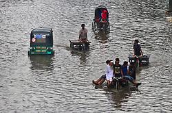 August 2, 2017 - Dhaka, Bangladesh - People commute on the flooded streets onNotre Toyenbee Circular Road after Wednesday's rain. (Credit Image: © Sony Ramany/NurPhoto via ZUMA Press)