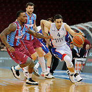 Anadolu Efes's Dogus Balbay (R) during their Turkish Basketball League Play Off Semi Final round 2 match Anadolu Efes between Trabzonspor at Abdi Ipekci Arena in Istanbul Turkey on Friday 31 May 2015. Photo by Aykut AKICI/TURKPIX