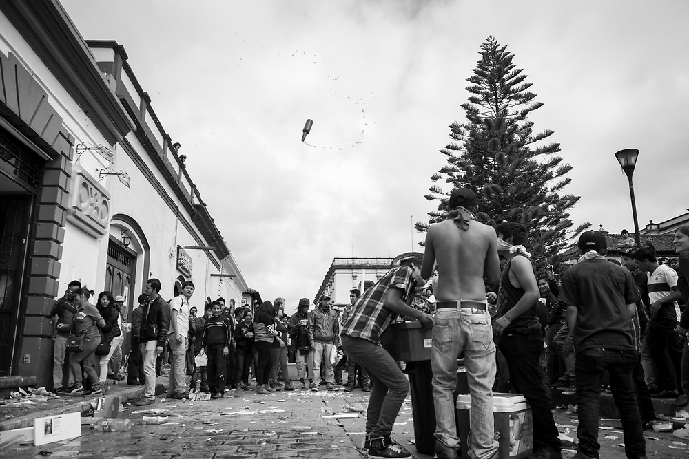 A beer bottle twirls through the air as looters clean out an OXXO convenience store in San Cristobal de las Casas, Mexico. This day protest where held across Mexico protesting the government's handling of and involvement in the disappearance of 43 students on September 26, 2014 in Iguala.