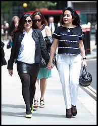 """Consultant Daad Sharab (right) arrives with her daughter  at the High Court she claims Saudi Prince Al-Waleed Bin Talal Bin Abdul-Aziz Al-Saud owes her around £6.5 million commission for the part she played in a 2005 Airbus deal. Prince Al-Waleed disputes her claim and denies that any agreement was made for a """"specific commission"""". London, United Kingdom<br /> Monday, 1st July 2013<br /> Picture by Piero Cruciatti / i-Images"""