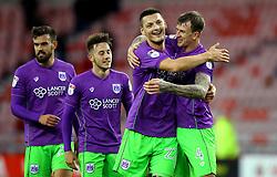 Aden Flint of Bristol City celebrates with match winner Milan Djuric of Bristol City after the win over Sunderland - Mandatory by-line: Robbie Stephenson/JMP - 28/10/2017 - FOOTBALL - Stadium of Light - Sunderland, England - Sunderland v Bristol City - Sky Bet Championship