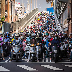Taiwan's public transportation system has a great reputation for its efficiency and convenience. On the streets and highways, buses are literally everywhere. It is the cheapest way to explore Taiwan. But still, many commuters prefer scooters to get from the outskirts into Taipei downtown, making the morning rush hour a somewhat polarious event.