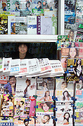 A magazine vendor sells a large variety of pulications from a kiosk in western Beijing. China has angered international rights groups and media organisations with its new curbs on foreign journalists and news agencies. Authorities have announced ÎrulesÌ requiring foreign media to get the approval of the government news agency, Xinhua, before releasing or distributing any news reports, pictures and graphics within China. The new rules empower Xinhua to censor and/or delete any content that it sees as a ÎthreatÌ to national security and unity. In fact, Chinese parliament is currently deliberating a bill that would fine domestic and foreign media if they broke news on natural disasters and other emrgencies without authorisation...