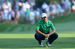 Jordan Spieth crouches near his ball on the first fairway during first round action of the PGA Championship at Quail Hollow Club Thursday, Aug. 10, 2017 in Charlotte, N.C. (Photo by Jeff Siner/Charlotte Observer/TNS/Sipa USA)  *** Please Use Credit from Credit Field ***