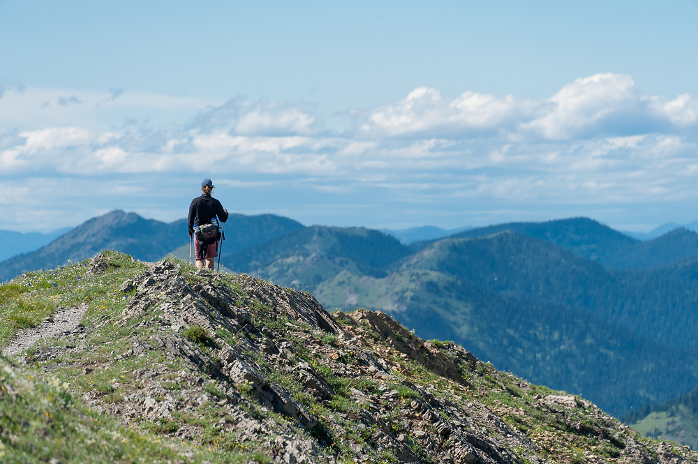 Hiker in Jewel Basin, an area of the Swan Mountains of the Northern Rockies in NW Montana near Bigfork.