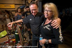 """The Buffalo Chip's Rod """"Woody"""" Woodruff and Carrie Repp at the Industry party at Bill Dodge's bike shop during the 2015 Biketoberfest Rally. Daytona Beach, FL, USA. October 16, 2015.  Photography ©2015 Michael Lichter."""