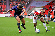 Doncaster Rovers forward Mallik Wilks (7) and Luton Town defender Matthew Pearson (6) during the EFL Sky Bet League 1 match between Doncaster Rovers and Luton Town at the Keepmoat Stadium, Doncaster, England on 8 September 2018.