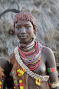 Africa, Ethiopia, Omo River Valley, Woman of the Hamer Tribe The hair is coated with ochre mud and animal fat