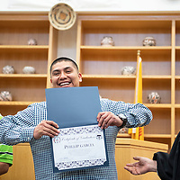 Phillip Garcia, center, shows off his Certificate of Graduation from the Pueblo of Acoma Wellness Court Program after Randolph Marshall Collins, Chief Judge, Pueblo of Acoma Tribal Court, right, presents him with the certificate in his courtroom Thursday, March 14 while Darin Victorino Jr., left, another graduate of the Wellness Court watches.