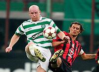 MILANO, STADIO GIUSEPPE MEAZZA, 29/09/2004<br /> <br /> CHAMPIONS' LEAGUE MATCHDAY 2<br /> <br /> INCONTRO AC MILAN-CELTIC GLASGOW 3-1<br /> <br /> JOHN HARTSON Celtic (SX) E PAOLO MALDINI Milan<br /> <br /> FOTO GRAFFITI