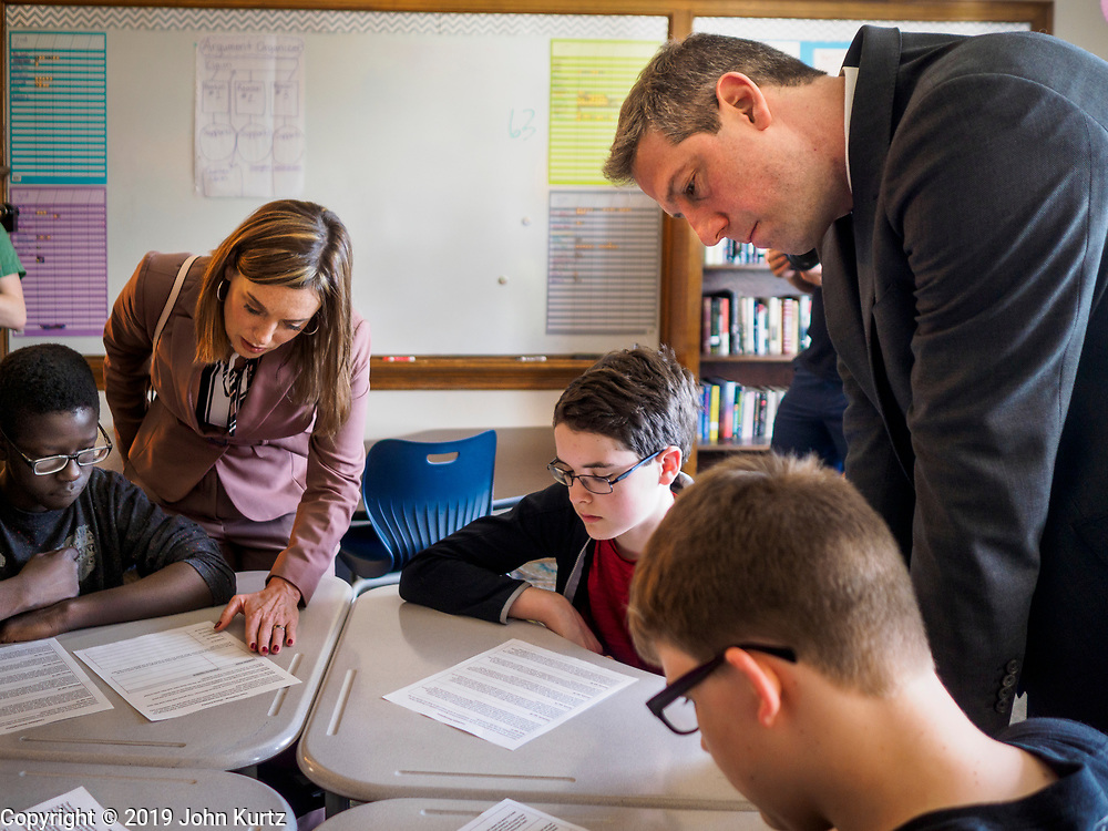 """08 APRIL 2019 - DES MOINES, IOWA: Rep. TIM RYAN (right) and his wife, ANDREA RYAN (center), visit a classroom at Callanan Middle School. Ryan, a candidate for the Democratic ticket of the US presidency, visited Callanan Middle School in Des Moines to discuss education issues. Ryan declared his candidacy on the US television show """"The View"""" on April 4. Ryan, 45 years old, represents Ohio's 13th District, which includes Lordstown, where a large General Motors plant recently closed. He is the latest Democrat to announce his candidacy to be the Democratic nominee in the 2020 election. Iowa holds its presidential caucuses on Feb. 3, 2020.       PHOTO BY JACK KURTZ"""