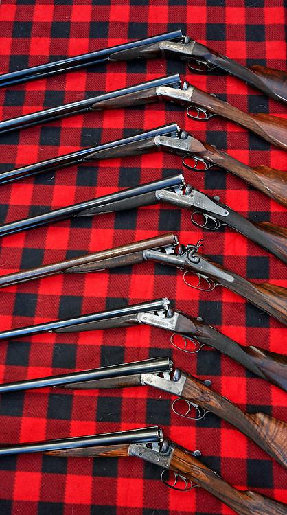 "British Double Guns. Top to Bottom: Alex Martin ""Ribless"", W.J. Jeffery, W.R. Pape, J. Blanch ""Back-action"", J. Blanch Sidelever, Army & Navy ""Screw-grip"", Army & Navy, John Wilkes,"