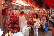 Shop selling meat in Wan Chai's thronging food market on Bowrington Road in Hong Kong, China. Almost any food can be bought here, both fresh or cooked. Wan Chai is a busy Chinese shopping district totally different to nearby westernised Central.