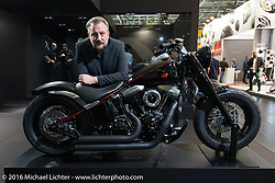 Alessandro Taglioretti in the Rizoma display showing off his beautiful Italian parts for motorcycles at the Intermot Motorcycle Trade Fair. Cologne, Germany. Wednesday October 5, 2016. Photography ©2016 Michael Lichter.