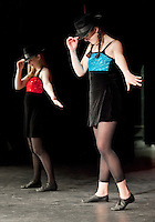 """Executive Director for the Pemi Youth Center Jessica Dutile and dancer Eliza Berg practice their rendition of """"Chicago"""" during final rehearsal for the Dancing with the Lakes Region Stars at the Inter Lakes High School auditorium Thursday evening.  (Karen Bobotas/for the Laconia Daily Sun)"""