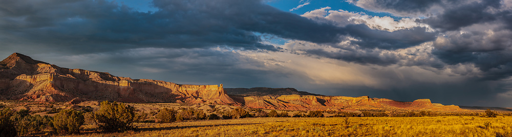 Stormy sky over the sandstone cliffs at the west side of Mesa Montosa, Chama Basin, New Mexico. Ghost Ranch is in the center, just right of the prominence named Chimney Rock. © David A. Ponton