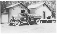 "Conoco truck standing beside Conoco warehouse.<br /> Dolores, CO  1930-1939<br /> In book ""Rocky Mountain Railroads - Vol. 1: The Rio Grande Southern"" page 74<br /> Also in ""RGS Story Vol. VII"", p. 123."