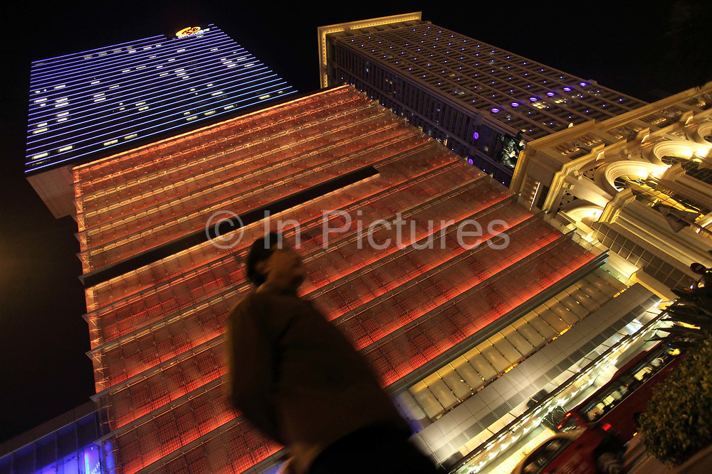 Pedestrians walk past the Galaxy Entertiament Group's Starworld Casino in Macau, China on 27 January 2011. A relative newcomer to the rapidly expanding Macau gambling scene, the Galaxy hopes its new casino will hold up its own against the likes of the Venetian, Wynn, MGM, and the Lisboa.