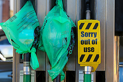 © Licensed to London News Pictures. 03/10/2021. London, UK. 'Sorry out of use' sign and pumps covered with plastic bags at Tesco petrol station in north London as the fuel crisis continues. The petrol station has run out of petrol and has limited supply of diesel, which will last until 2pm today. From tomorrow (4 October) military personnel, including 100 drivers, will start fuel deliveries. Photo credit: Dinendra Haria/LNP