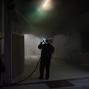 Firefighter trying  to put off a fire in a bank in Panepistimiou street during the the protests in Athens against the  unpopular austerity measures, June 29, 2011