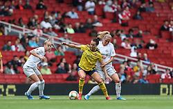 Viktoria Schnaderback of Arsenal holds the ball up under pressure from Sydney Lohmann of Bayern Munich - Mandatory by-line: Arron Gent/JMP - 28/07/2019 - FOOTBALL - Emirates Stadium - London, England - Arsenal Women v Bayern Munich Women - Emirates Cup
