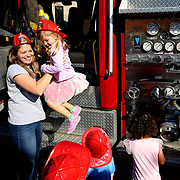 Beth Ryan, a Pre-K teacher, left, helps Morgan Stacy, 4, of Sylvania, down from inside the fire truck brought during a fire safety presentation by the Toledo Fire and Rescue Department for the Pre-K class at Love 'n Learn Educational Child Care in Toledo on Tuesday, October 9, 2018. THE BLADE/KURT STEISS