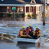 A swift water rescue team transports a resident of to safety on a street covered with floodwaters caused by rain from Hurricane Matthew in Lumberton, N.C., Monday, Oct. 10, 2016. (AP Photo/Mike Spencer)