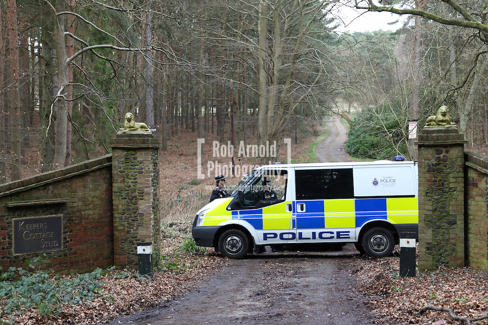 24/02/2014. Farnham, Surrey, UK. Police guarding the entrance to a property off of Waverley Lane near Farnham, Surrey, where 2 bodies and 4 dead dogs have been found. Photo by Rob Arnold