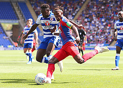 """Crystal Palaces Wilfried Zaha crosses the ball during the pre-season friendly match at the Madejski Stadium, Reading. PRESS ASSOCIATION Photo. Picture date: Saturday July 28, 2018. See PA story SOCCER Reading. Photo credit should read: Mark Kerton/PA Wire. RESTRICTIONS: EDITORIAL USE ONLY No use with unauthorised audio, video, data, fixture lists, club/league logos or """"live"""" services. Online in-match use limited to 75 images, no video emulation. No use in betting, games or single club/league/player publications."""